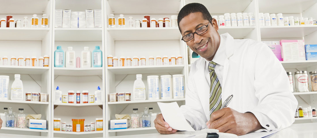 pharmacist holding a pen and paper