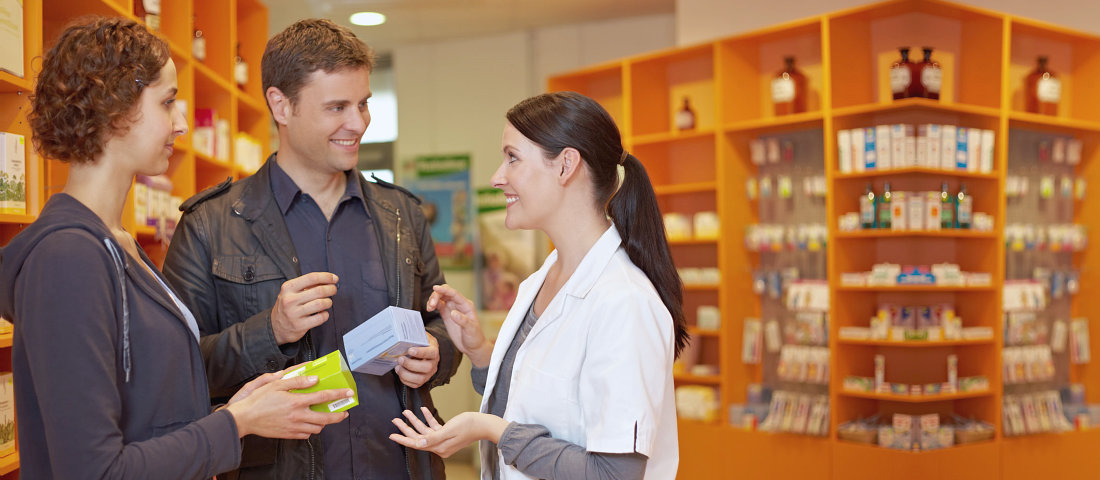 pharmacist explaining to couple customers