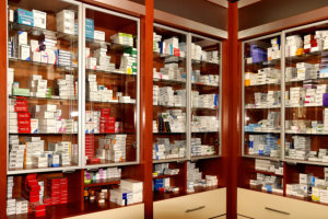 different types of medicine in a cabinet