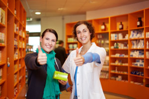 pharmacist and a customer with thumb's up